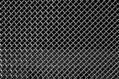 enmesh: Abstract steel grid from car radiator. Black background