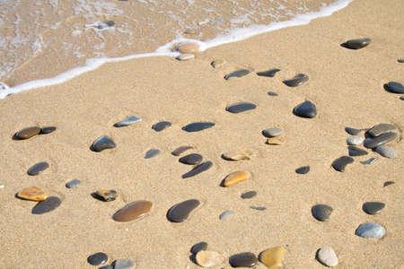 Golden sand beach at the sea. Rocks, waves photo