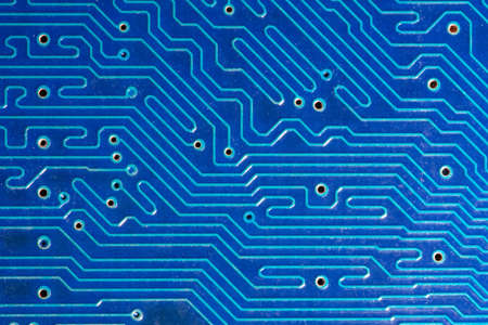 extremely: Blue computer motherboard with traces. Extremely close-up Stock Photo