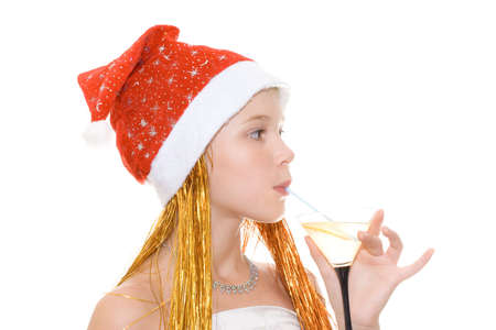 Beauty teenager girl in red Christmas Hat with cocktail.  Stock Photo - 2109211
