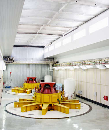 Huge water turbine generators. Hydroelectric powerplant. Interior photo