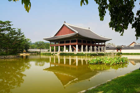 a traditional korean: Emperor palace at Seoul. South Korea. Lake. Building. Reflections Stock Photo