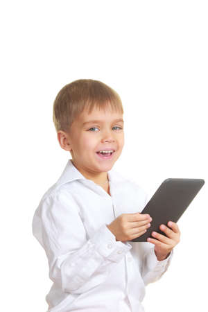 Smiling reading boy with electronic book  Isolated on white photo