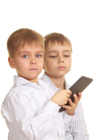 Two reading boys with electronic book  Focus at near boy photo