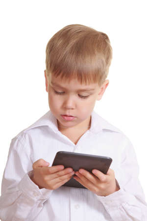 kindle: Reading boy with electronic book  Isolated on white Stock Photo