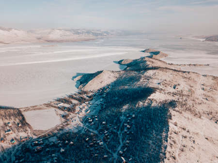 Baikal water lake winter season aerial view with sunrise sky, Russia natural landscape