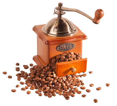 Old coffee grinder with beans photo