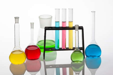 Chemisty set, with  test tubes and beakers filled with multicoloured liquids  photo