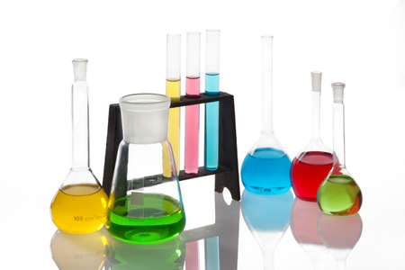 Chemistry set with  test-tubes and beakers filled with multicolored liquids  photo
