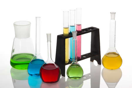 Chemistry set with  test-tubes and beakers filled with multicolored liquids. photo