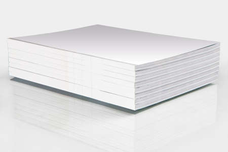 Stack of magazines with a blank cover, isolated on white photo