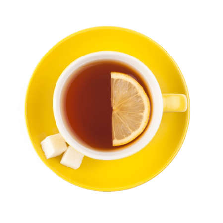 tea light: Yellow teacup with sugar and lemon isolated on white background
