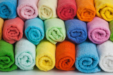 Set of colored towels on white .