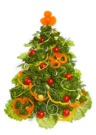 Christmas tree made of different vegetarian food, isolated on white background photo