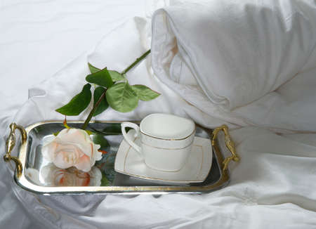 waved: tray with cup and rose on silk Stock Photo