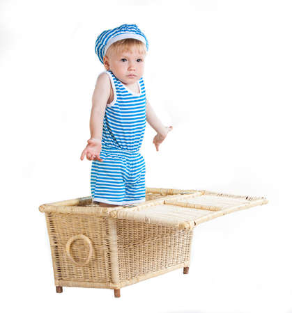 conscription: cute little boy in wicker basket, isolated on white background