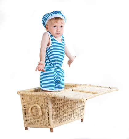 cute little boy in wicker basket, isolated on white background
