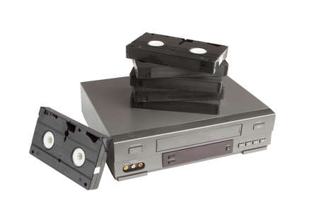vhs videotape: stack of videotapes on videorecorder isolated on white background