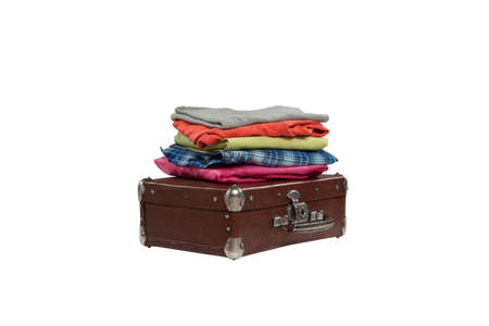 stack of clothes on suitcase isolated on white background