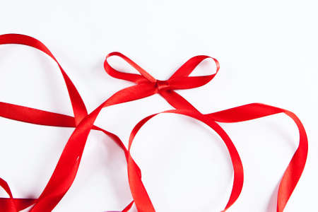waved: waved red ribbon isolated on white background