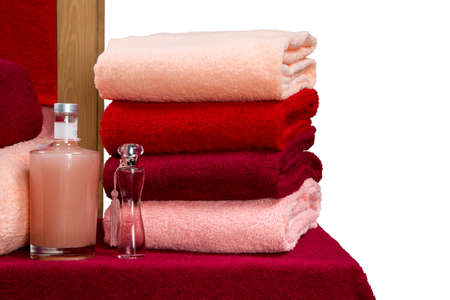 a neat stack of terry towels on a rack isolated on white background photo