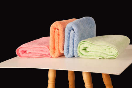 terry: colorful terry towels isolated on dark background Stock Photo