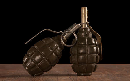 two hand grenade on wooden table
