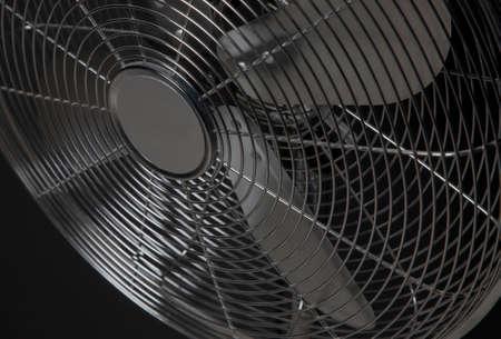 ventilate: closeup metal fan on black background