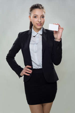specifies: young woman with empty business card