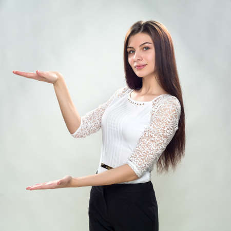 specifies: young business woman holding copy space Stock Photo