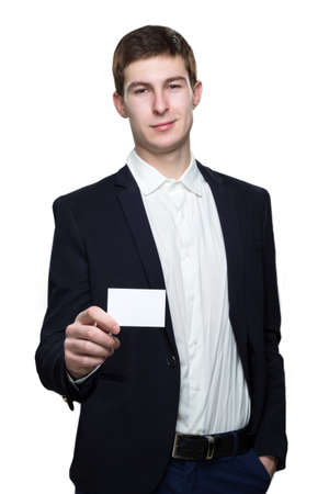 specifies: young business man with empty business card on white background Stock Photo