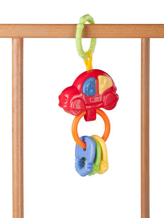 babys toy hanging on a cot isolated on white background Stok Fotoğraf