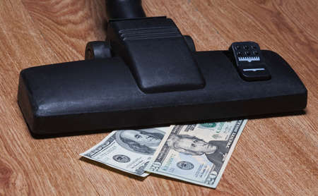 arrears: american dollars sucked with vacuum cleaner