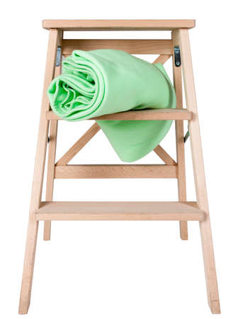 green blanket on a stepladder  isolated on white background