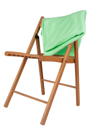 green blanket on a wooden chair isolated on white background