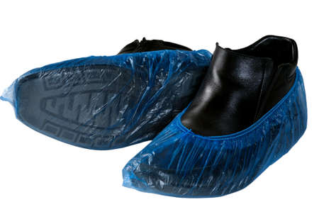 Shoe covers on boots isolated on white background