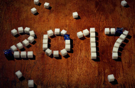 the description 2017 made by sugar cube on wooden table Stok Fotoğraf