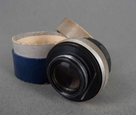 lens to the camera on a gray background