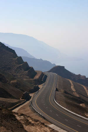 lonelyness: The road by the Dead Sea, Jordan Stock Photo