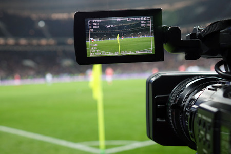 Live broadcast of a football match.The view through the camera screen.