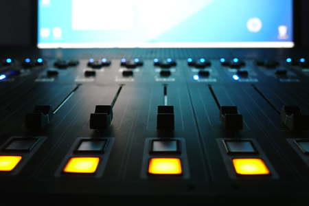 The audio mixer in the Studio, the handles move up and down, all ready to record.