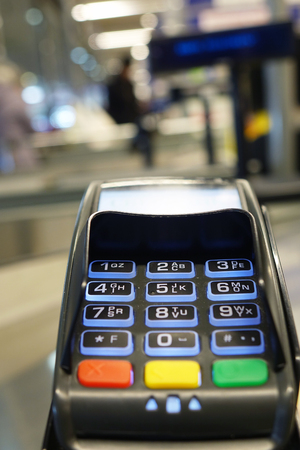 Payment terminal by credit card . Payment in the store.