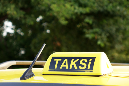 Taxi car roof sign on bokeh background in Istanbul of Turkey Stock Photo