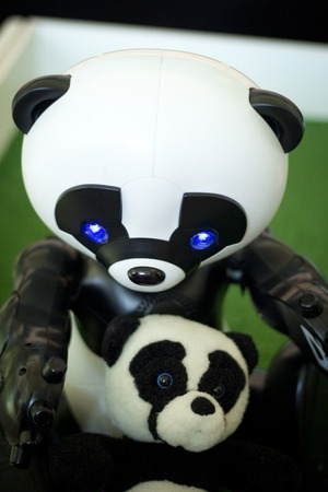 A small robot in the form of a Panda, as a toy for children and adults . Technology. Robotics. Redactioneel