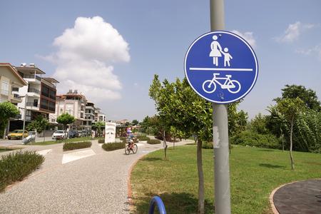 Turkey.Manavgat-June 2018. Cyclist & pedestrian road sign. Traffic in town.