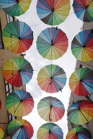 Colorful umbrellas background. The sky of colorful umbrellas