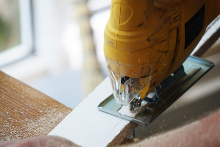 Working with an automatic electric saw works in a carpentry workshop. The concept of handmade Stok Fotoğraf