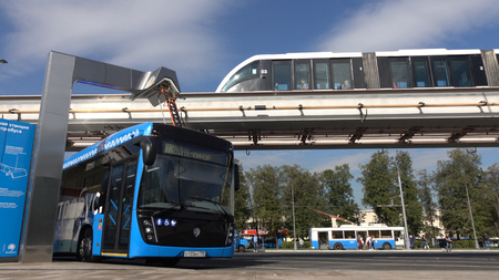 Moscow, Russia-September 2017:The concept of urban transport .Blue electric bus at the charging station.Modern train passing on the monorail. The concept of ecological future. Editorial