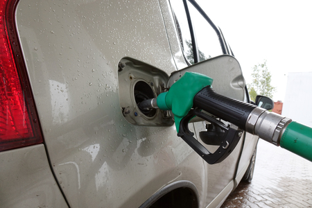Petrol station. Filling the car with fuel .