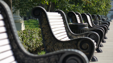 Cast iron benches with wooden slats for seats
